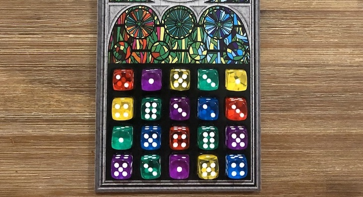 A completed game of Sagrada, showing off the variety of colors used by the translucent dice