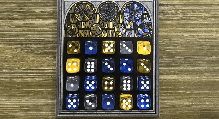 A completed game of Sagrada, showing off the variety of colors used by the translucent dice, with simulated deuteranopia.