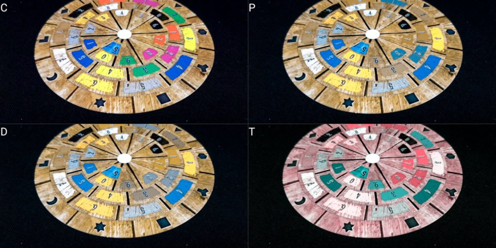 Decoder disk from Exit: The Game, The Abandoned Cabin, rendered in normal color vision and simulated colorblindness for the three most common types of colorblindness.